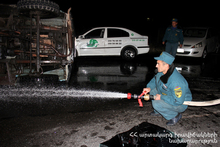 The rescuers carried out cleaning up actions of the roadway
