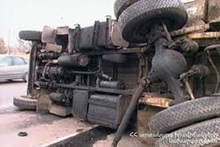 A truck ran off the roadway and turned over onto its side