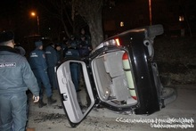 A car crashed into a fence and turned over: there was a casualty