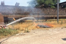 Firefighters extinguished fire broken out in grass areas