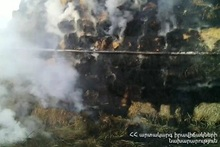 About 300 bales of hay were burnt in the yard of one of the houses