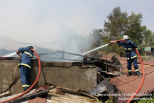 Rescuers extinguished the fire caught on the roof of a house