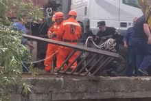 Rescuers brought the railing out of the river