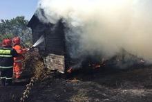 Wooden lodge and grassland burnt