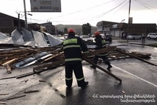 Roof of the building was damaged because of strong wind and fell on the roadway