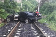 Car ran off the roadway and appeared on the railway