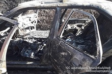 Firefighters extinguished the fire in the car