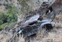 Car run off the roadway and rolled over into a gorge